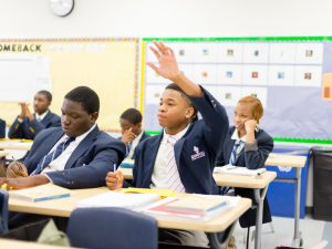 KIPP NCA Student Raises his hand.